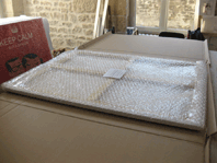 Canvas packaged in a protective bubble
